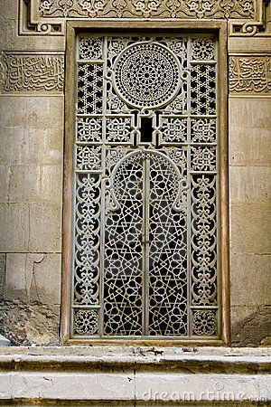 Large Window With Lots Of Work And Artistic Details Located