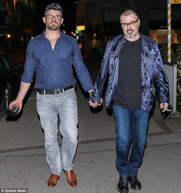 Rare outing: George Michael and boyfriend Fadi Fawaz made a rare outing together in Switze...