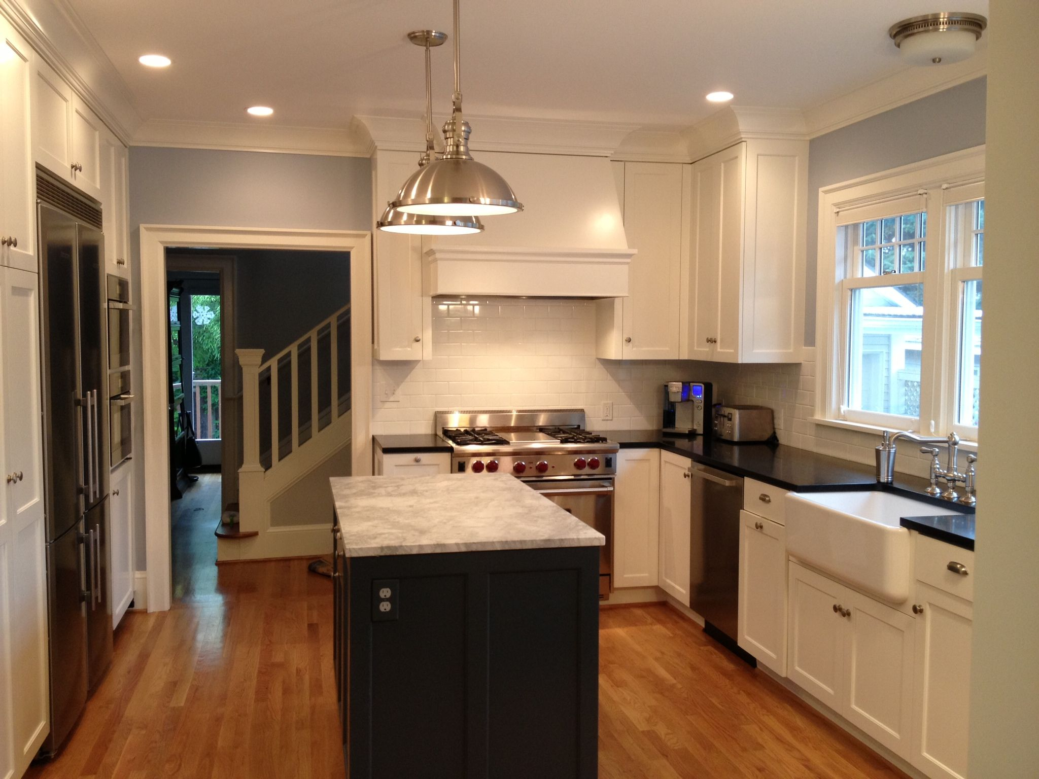 Elegant Full Kitchen View In 1920u0027s Home; White Custom Cabinets; Moonlight Marble  Island With Contrasting