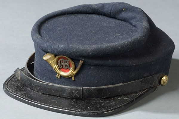 a3b51bc6aa9 Rare Civil War Kepi ca 1863-1867. Navy blue wool body with black leather  visor. Marine Corp hat insignia with bugle and silver M mounted on red  cotton.