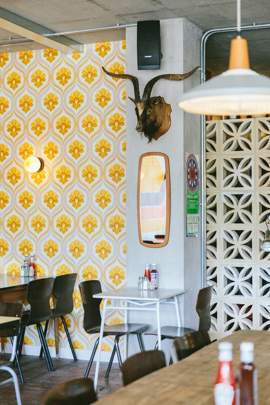 The Breakfast Club Hackney Wick by Finch Interiors. London restaurant. 70's  wallpaper.