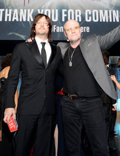 Norman Reedus and Michael Rooker onstage during the AMC's 'The Walking Dead' season 6 fan premiere event at Madison Square Garden on October 9, 2015 in New York City.