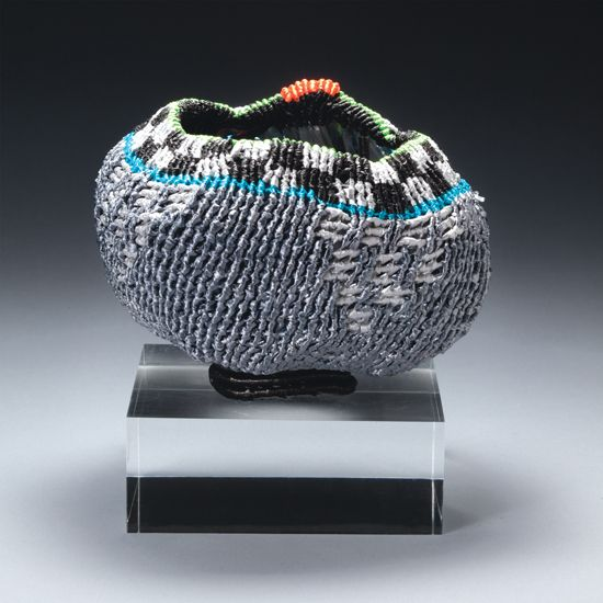"Orange Dot, a 'chawan' by Ed Bing Lee, 2008. Synthetic ribbon. Height 4"", Diameter 4""."