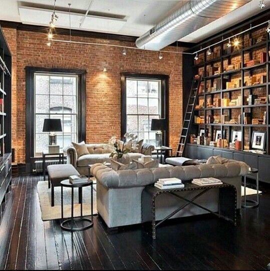 Industrial Loft Living Room Brick Walls Wall To Wall Built In Bookcase Sofas Dark Hardwood Floors Loft Living Modern Apartment Tribeca Apartment