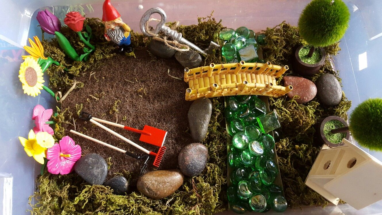 Gnome garden sensory bin with colored stones and plant pot drainage ...