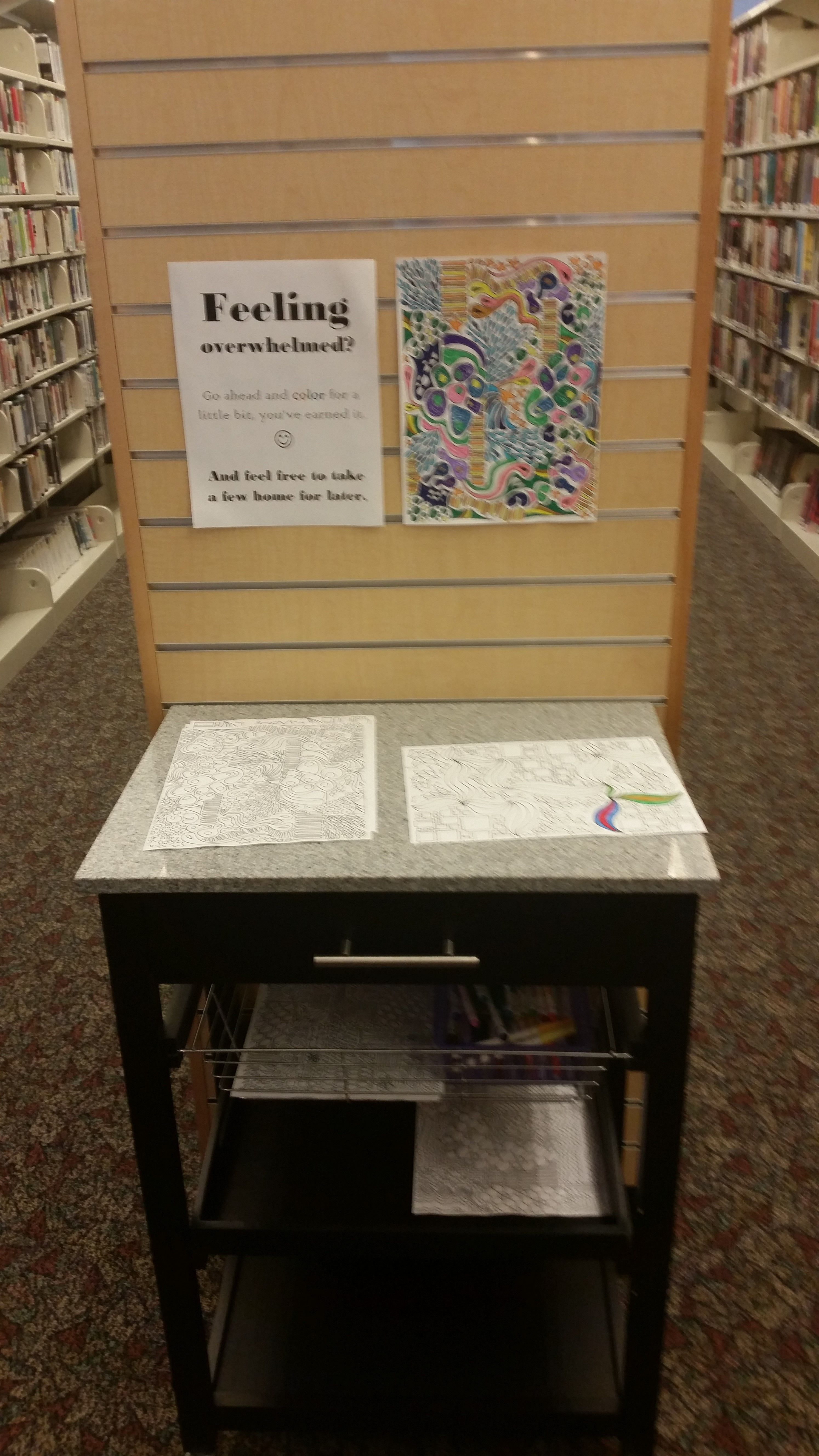 Coloring book station discovered at the end of a library stack. Richfield…