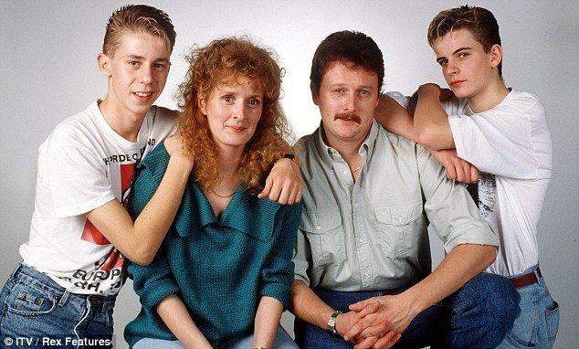 As it all began... A young Simon is seen posing with his screen family, consisting of Nicholas Cochrane (Andy McDonald), Beverly Callard (Liz McDonald) and Charles Lawson (Jim McDonald)