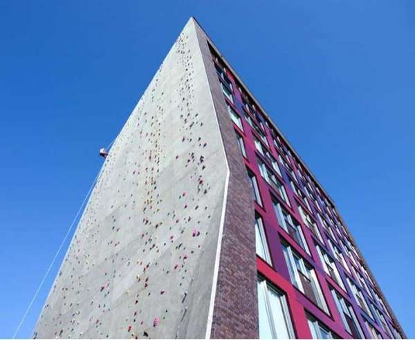 Student Housing building at the University of Twente in the Netherlands with a rock wall on the side