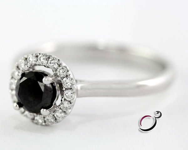 Rare and beautiful black diamond set in a vintage style halo ring. The centre black diamond is 0.50 carats with a total of 0.65 carats in total in the ring. The centre diamond is available in all carat weights as our diamond dealers have a large stock of black diamonds at all price points. This …