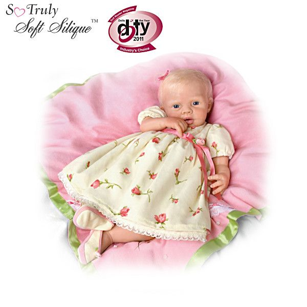 Lily Rose Silicone Baby Doll With 7 Piece Layette Set