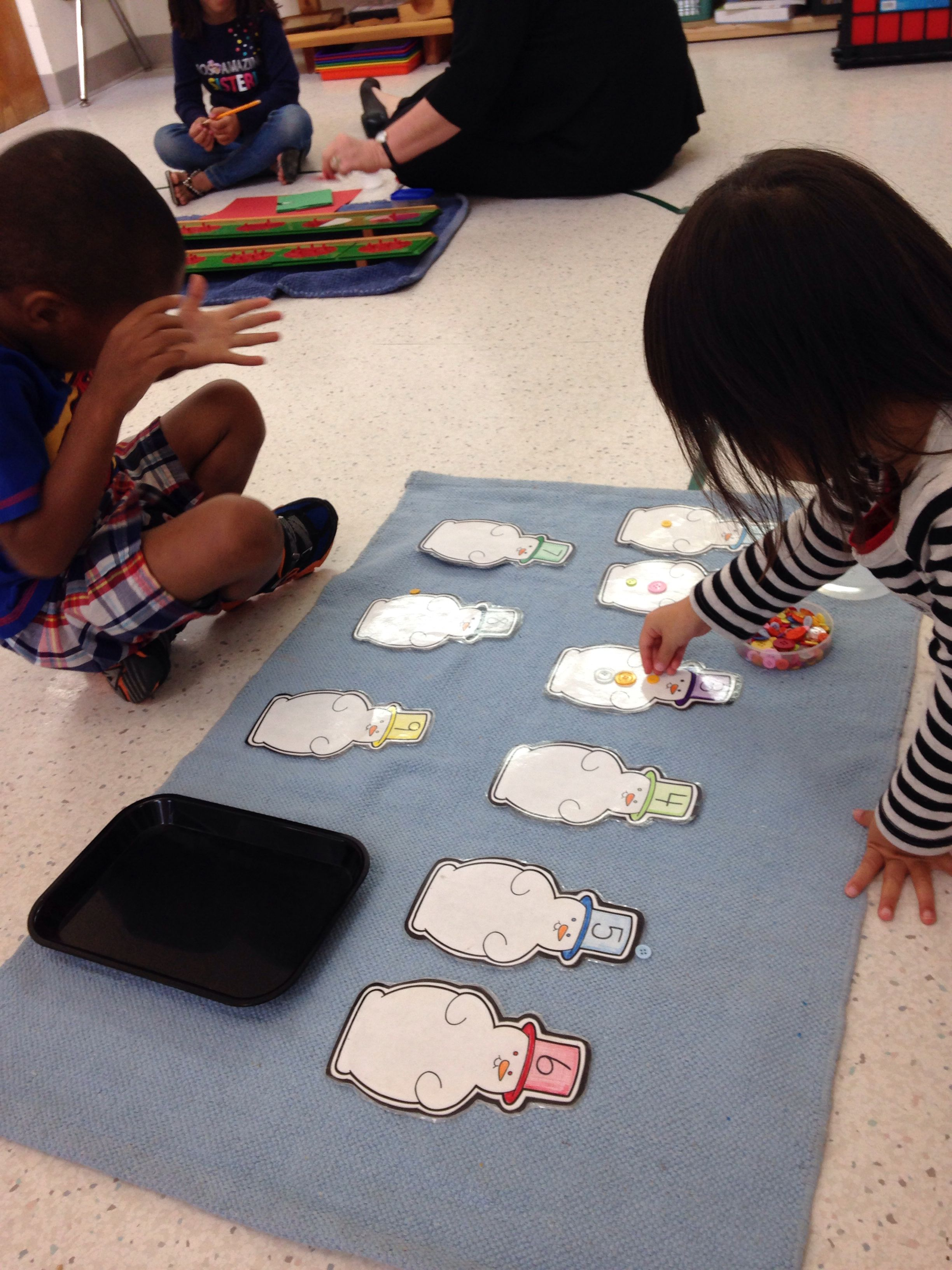 Learning Number Association By Placing Buttons On The Number On The