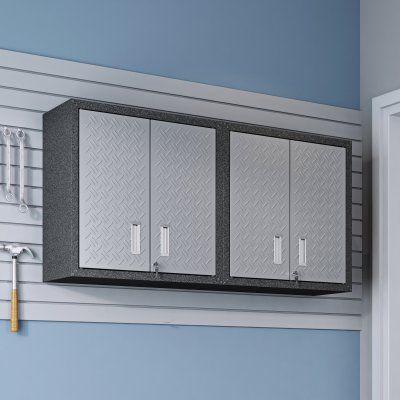 Manhattan Comfort Fortress Double Floating Textured Metal Garage Cabinet is part of Metal cabinet Texture - Dimensions (ea ) 30W x 12 5D x 30 3H in   Made of textured steel  Gray and dark gray finish  4 locking doors and 2 adjustable shelves  Locking doors with key  Recessed handles  Wall brackets included for wall mounting  Assembly required, hardware included  The Manhattan Comfort Fortress Double Floating Textured Metal Garage Cabinet mounts to your work shop or garage wall for storage that doesn't take up any floor space  The set includes two garage cabinets that each feature one adjustable shelf behind locking double doors  These wall cabinets are built of textured steel and include brackets that make it easy to mount to your wall