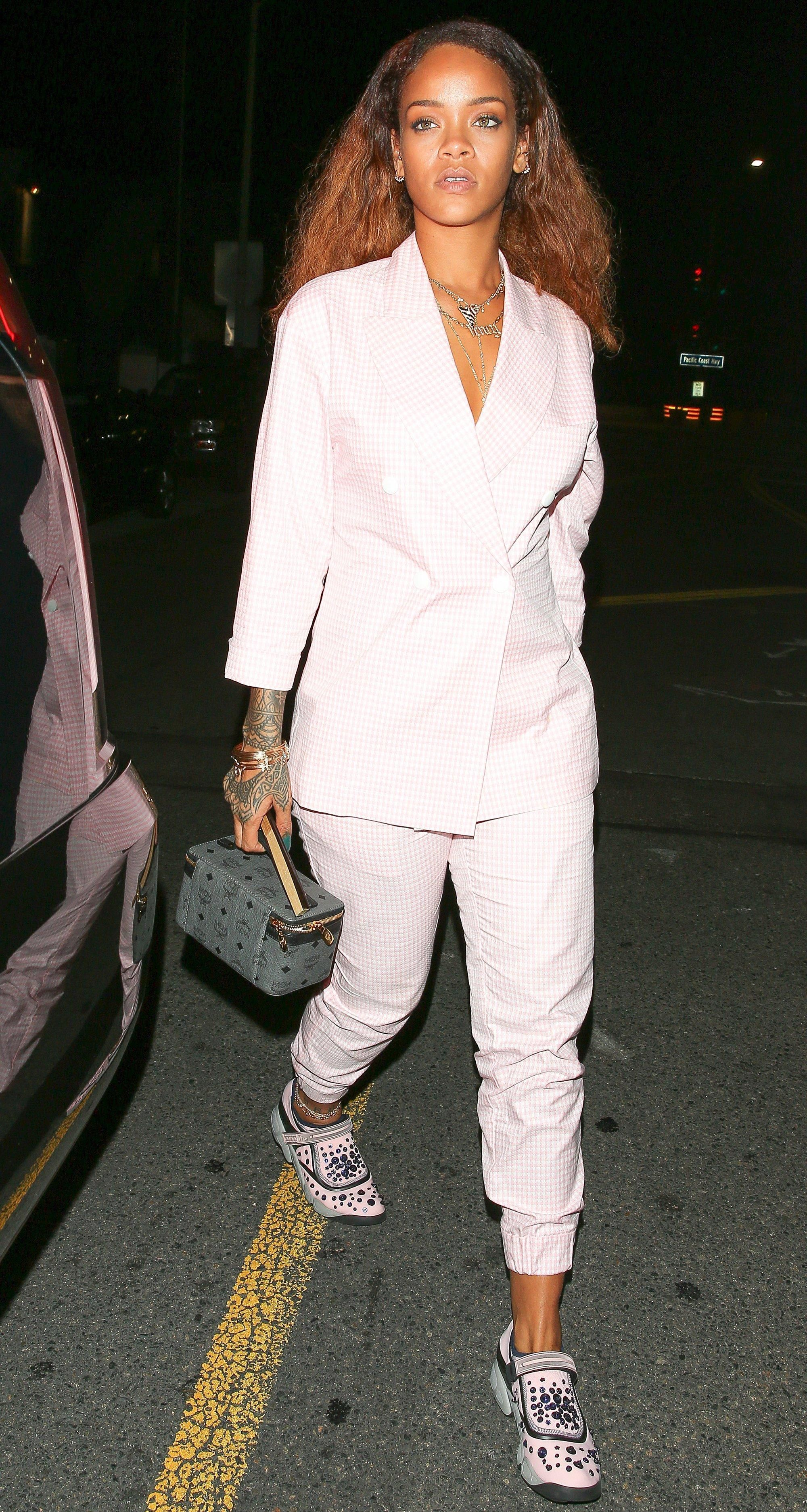 Rihanna in a pink gingham suit, Dior Shoes, and a gray MCM bag