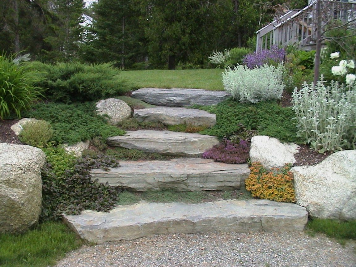 Steps in hillside private residence natural stone for Garden sectioning ideas
