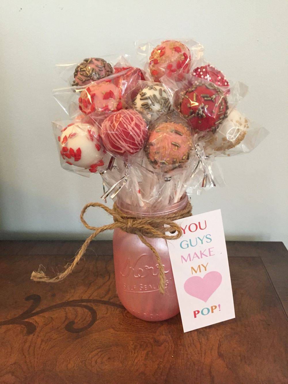 you make my heart pop bouquet of cake pops in a mason jar painted with pink pearl paint. Black Bedroom Furniture Sets. Home Design Ideas
