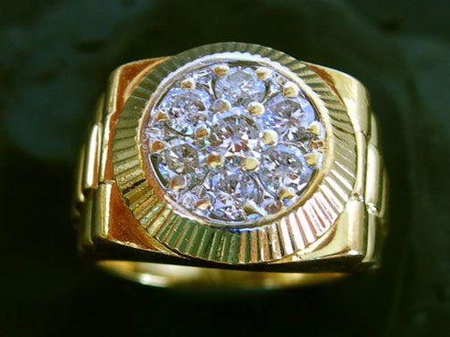 Diamond Rolex ring.