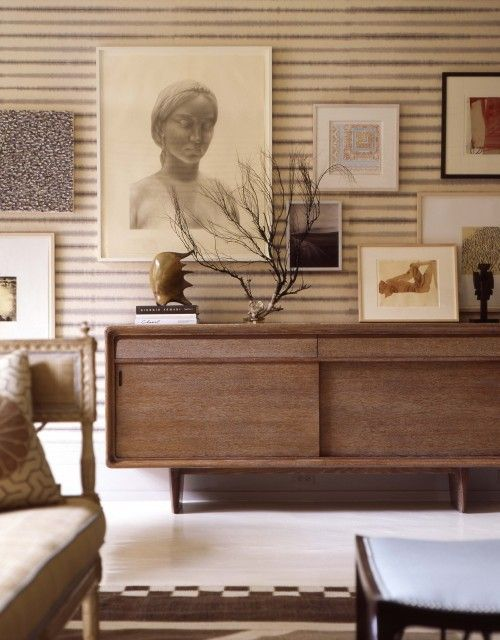 thom filicia midcentury modern living room design with walnut credenza ivory gray blue striped walls and art gallery