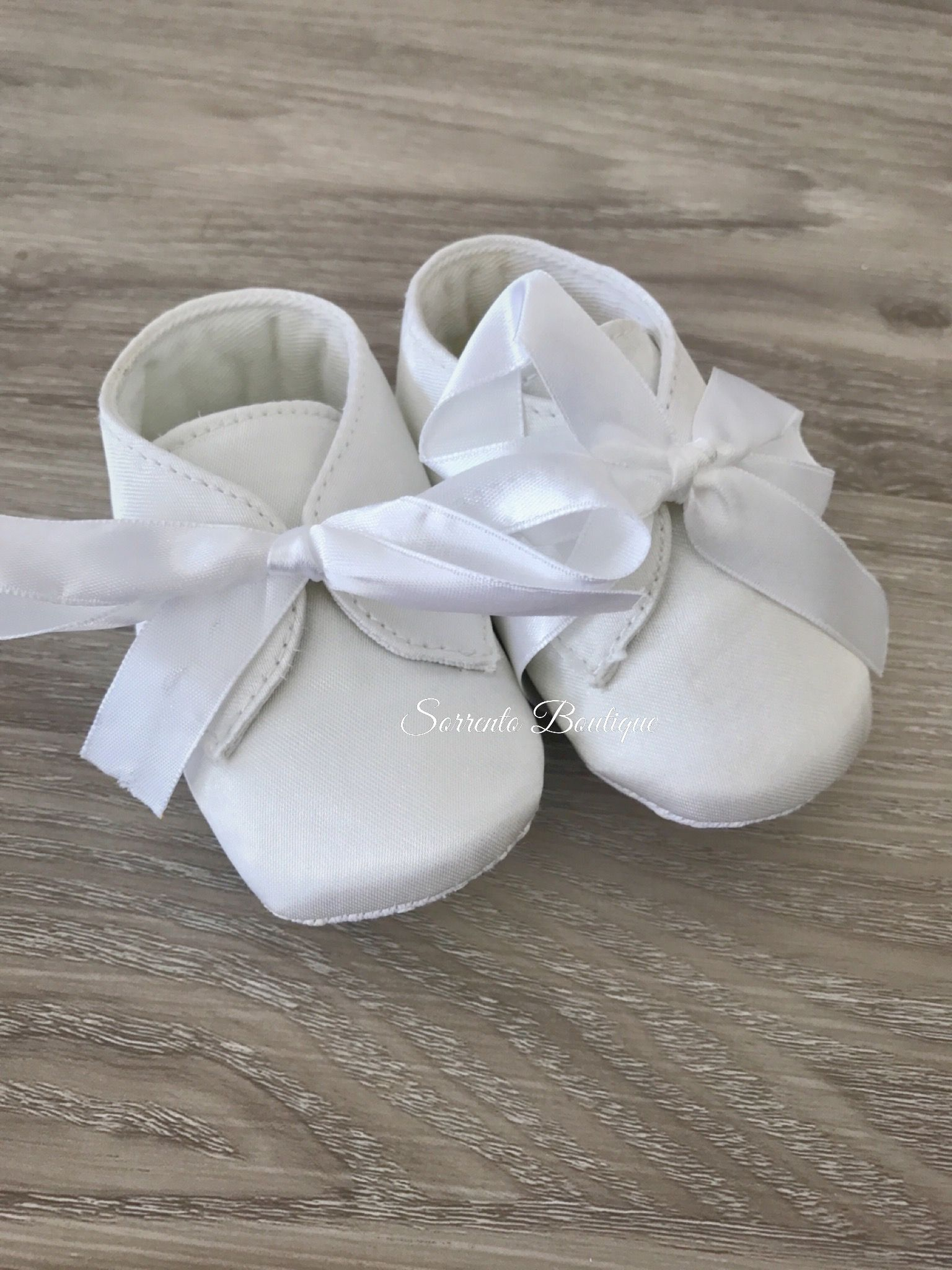 Baby boy satin boots are available in white or ivory