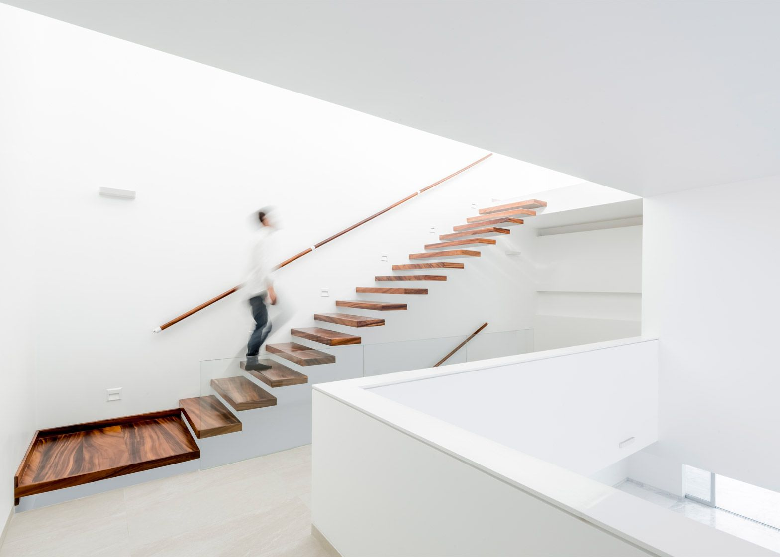 Cross-shaped frame supports double-height window in V House   STAIRS ...