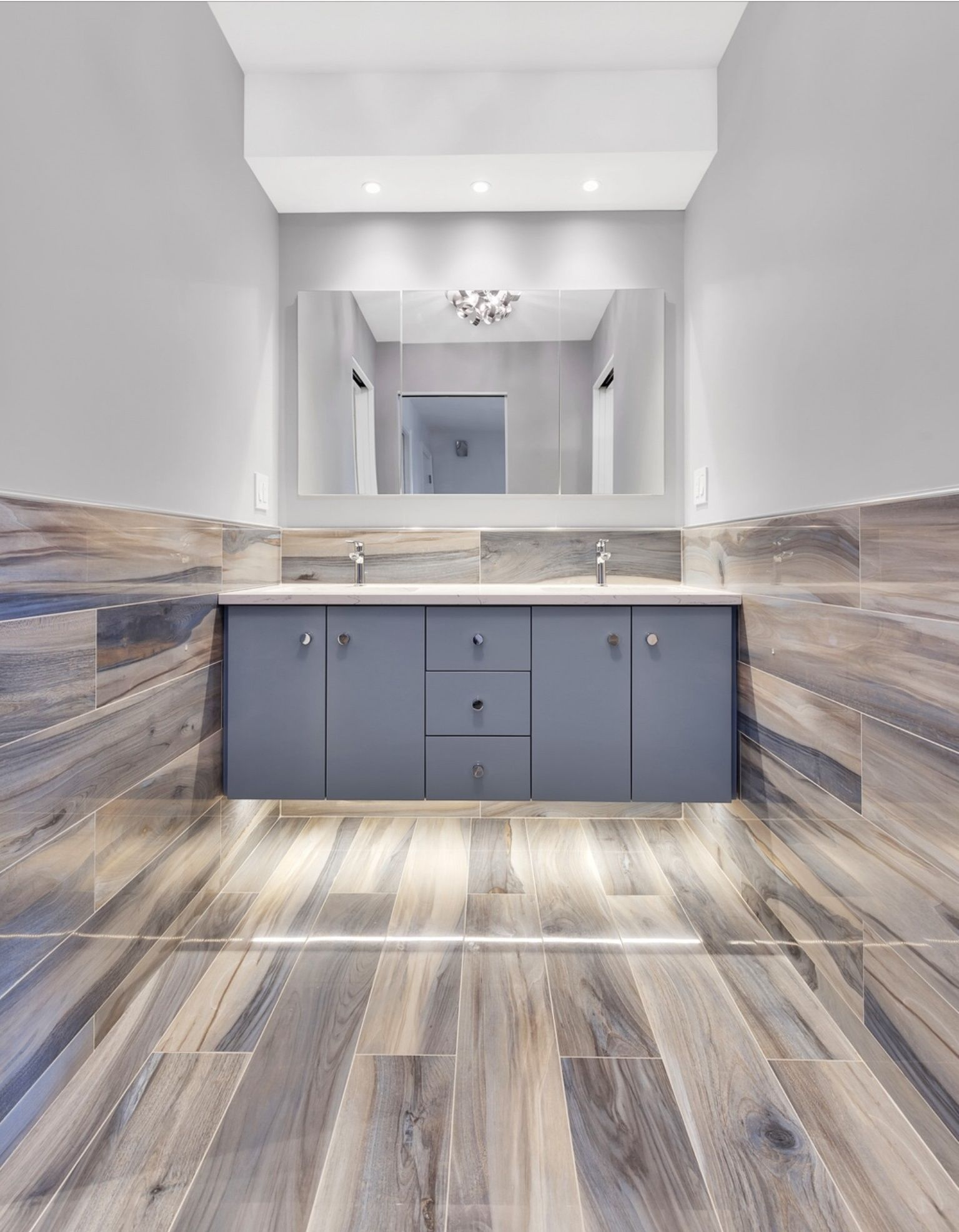 Artistic Tile I Our Wood Look Kauri Plank In Tasman Blue Adds Refinement And Warmth To This Upper East Side Ny Master Des House Flooring Wood Tile Floors Home