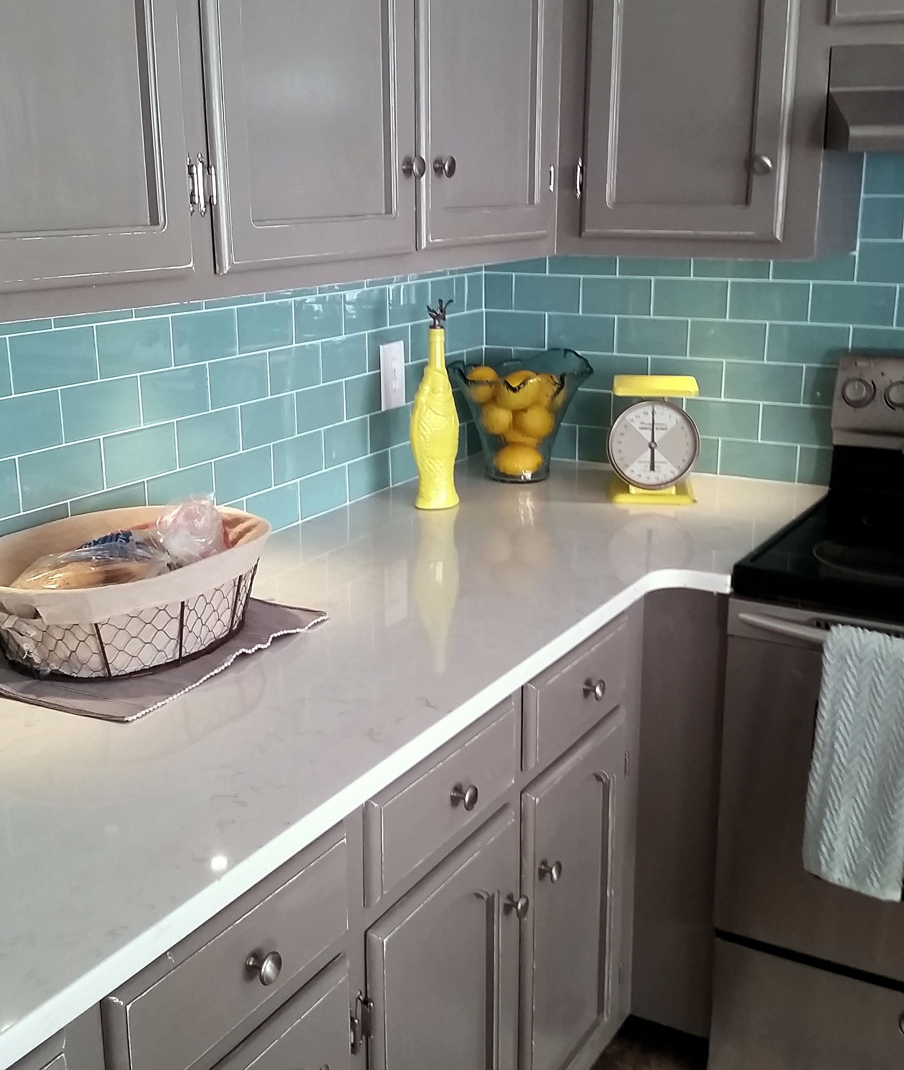 sage green glass subway tile subway tile outlet kitchen i m loving this color combination for a kitchen right now aqua green subway tile backsplash white countertops and gray cabinets