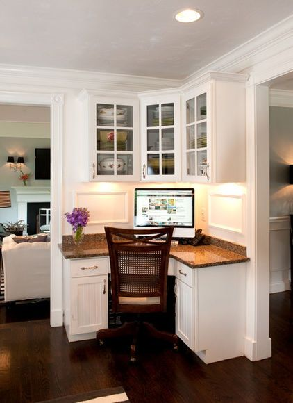 Create household central with a mini office. This kitchen workspace makes the most of a small corner, with upper and lower cabinets for storage and a computer for running the household. Note the thoughtful undercabinet lighting.