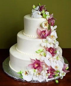 Three Tier White Wedding Cake With Cascading Fresh Pink Cymbidium Orchids And Phalaenopsis