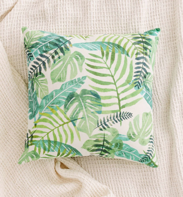 This tropical palm pillow. | 24 Unexpected Ways To Add Greenery To Your Home