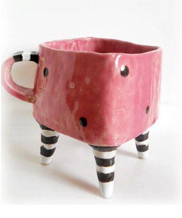 Coral pink Polka Dot Ceramic Mug with Four Legs in Black and White Stripe, Sweet Pink Polka Dot Mug. $18.00, via Etsy.