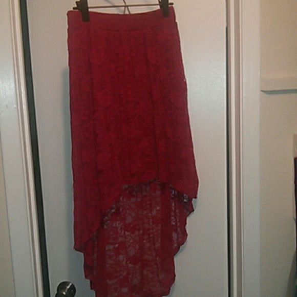 Red Hi-Lo skirt Red lacey hi-lo skirt from Charlotte Russe. Perfect to wear for NYE! Charlotte Russe Skirts High Low