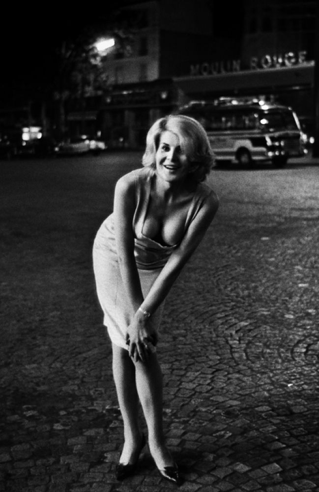 """'Christer Strömholm: Les Amies de Place Blanche' Captures Transexuals Of Paris Red Light District In 1960s. Strömholm photographed these transgender """"ladies of the night,"""" who were biological males forced into selling their bodies to raise funds to pay for sexual reassignment surgery. Born in Sweden, Strömholm moved to the Parisian neighborhood of Pigalle in 1959, where he walked the streets and became intimate friends with the night owls and prostitutes he met along the way."""