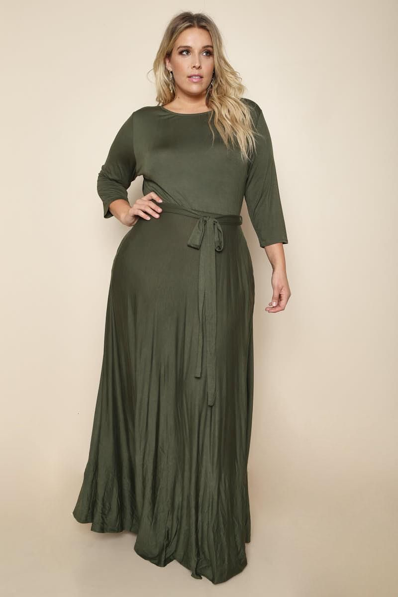 A feminine plus size maxi dress, featuring a solid knit