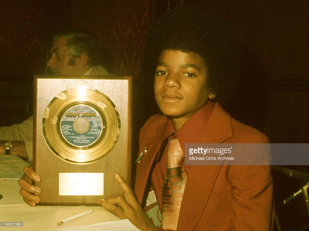 Pop singer Michael Jackson (1958-2009) poses for a portrait holding a plaque to commemorate milestone album sales of his single 'I Wanna Be Where You Are' which was released on May 27, 1972.