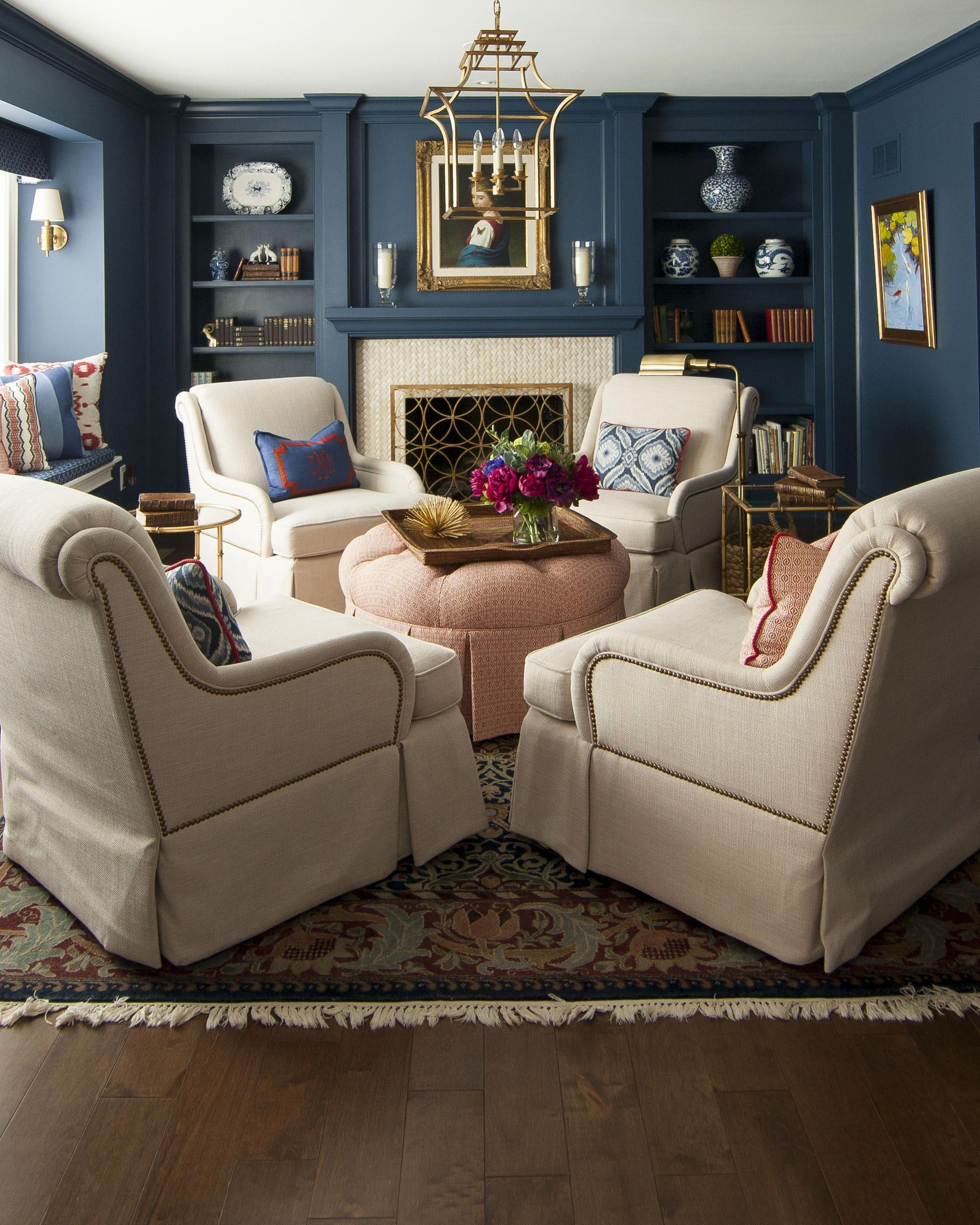 Four upholstered swivel chairs around a round ottoman