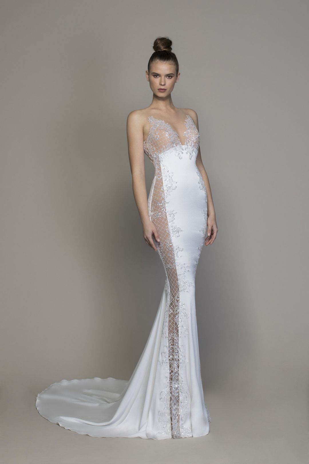 49c7162193 Sheath style gown made from crepe with lattice style sheer cutouts on sides  made from micro