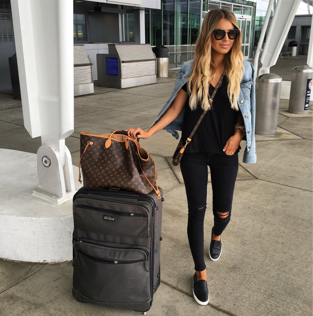 Black jeans t,shirt sneakers jean jacket casual airport