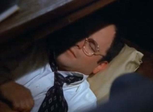 George Costanza From Seinfeld Attempting To Nap Under His Desk At Work Description From Ibtimes Com I Searched George Costanza Funny Blogs Napping At Work