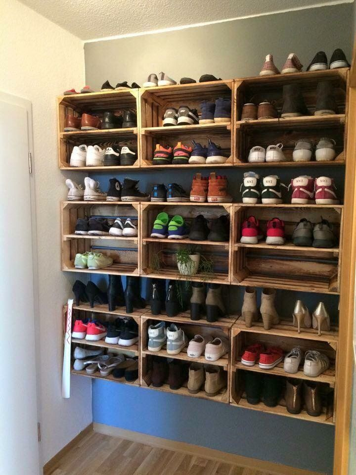 I like how they used wooden crates as shoe storage....fits alot of shoes! #garageideasstorage