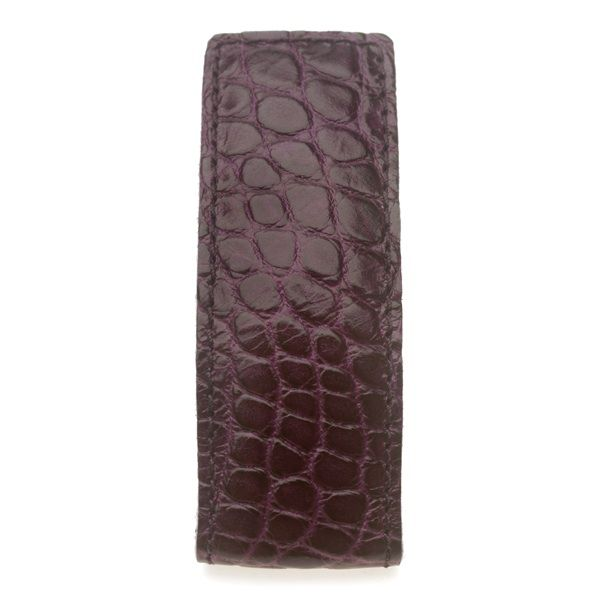 CROCO LAQ (dark purple)     Dressclip is designed for holding down your dress during cycling on windy days.  Clever.      Via Nomonro