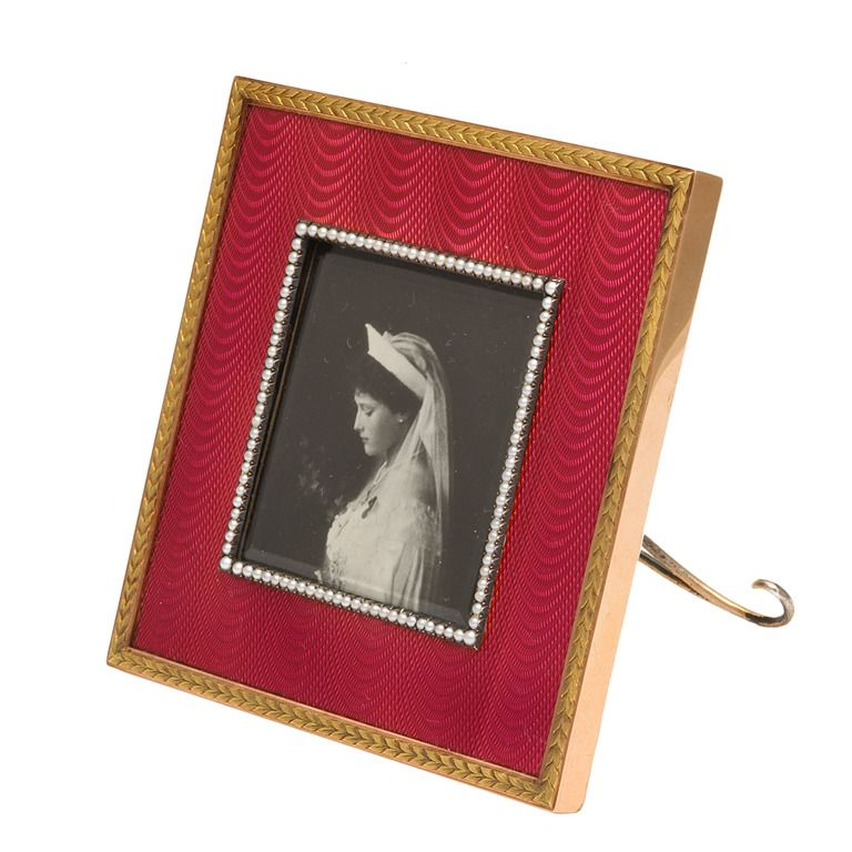 Photograph Frame By Fabergé, workmaster H. Wigstrom, St. Petersburg, 1908-1917. Square gold and raspberry guilloché enamel and pearl photograph frame. Purchased from Fabergé's London branch by H. M. Queen Alexandra (1844-1925) November 13, 1911.