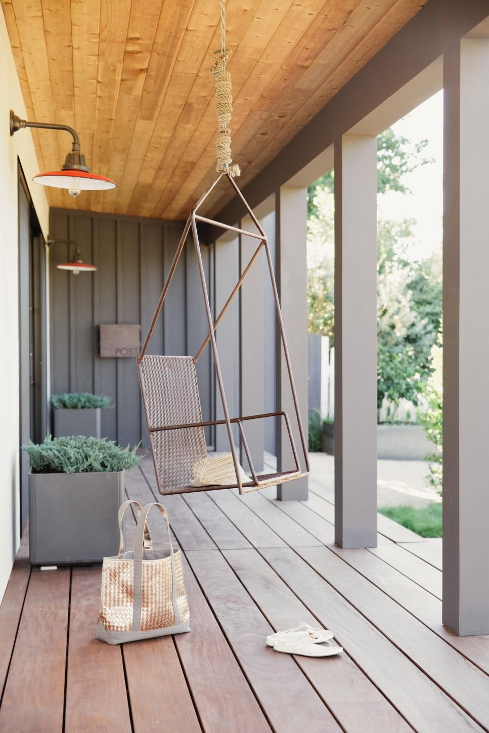 Best A Modern Metal Swing Hangs From The Wood Plank Ceiling On 400 x 300