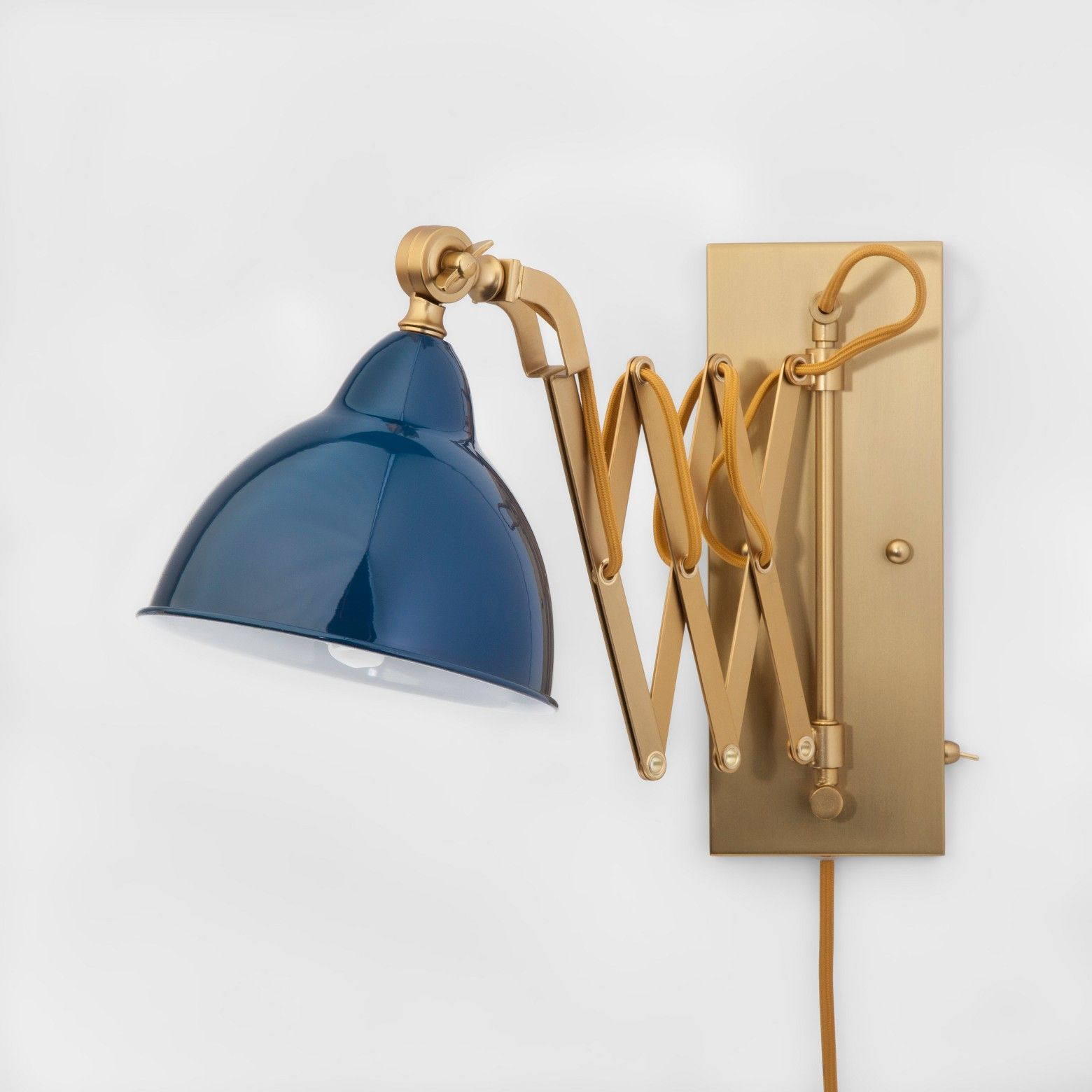 The Wall Sconce Lamp From Threshold Has A Blue Shade And Extends