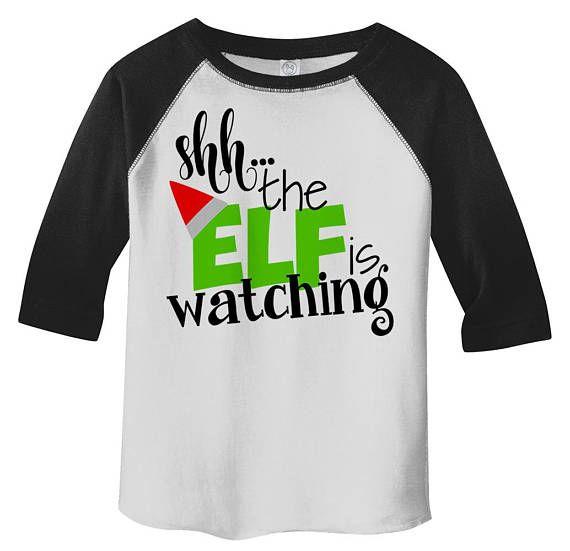 Shirts By Sarah Toddler Funny Santa Elf Is Watching 3 4 Sleeve Etsy Holiday Shirt Ideas Funny Christmas Shirts Christmas Tshirts
