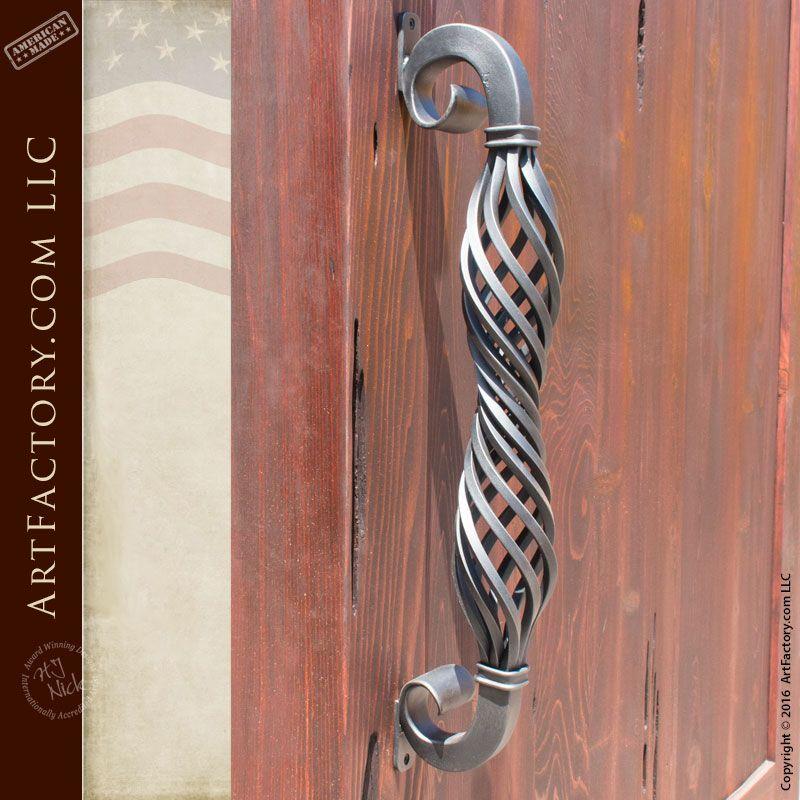 Artistic spiral design wrought iron door handle as shown on door ...