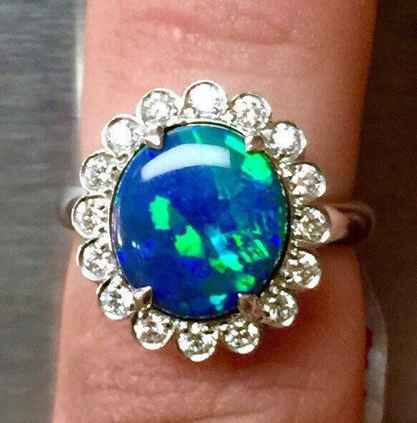 2.87ct Fine Black Opal with 0.47ctw Diamonds in Platinum by HarrisBlackOpals on Etsy https://www.etsy.com/listing/217468992/287ct-fine-black-opal-with-047ctw