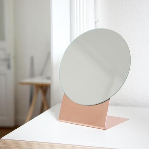 Rounded mirror with copper stand