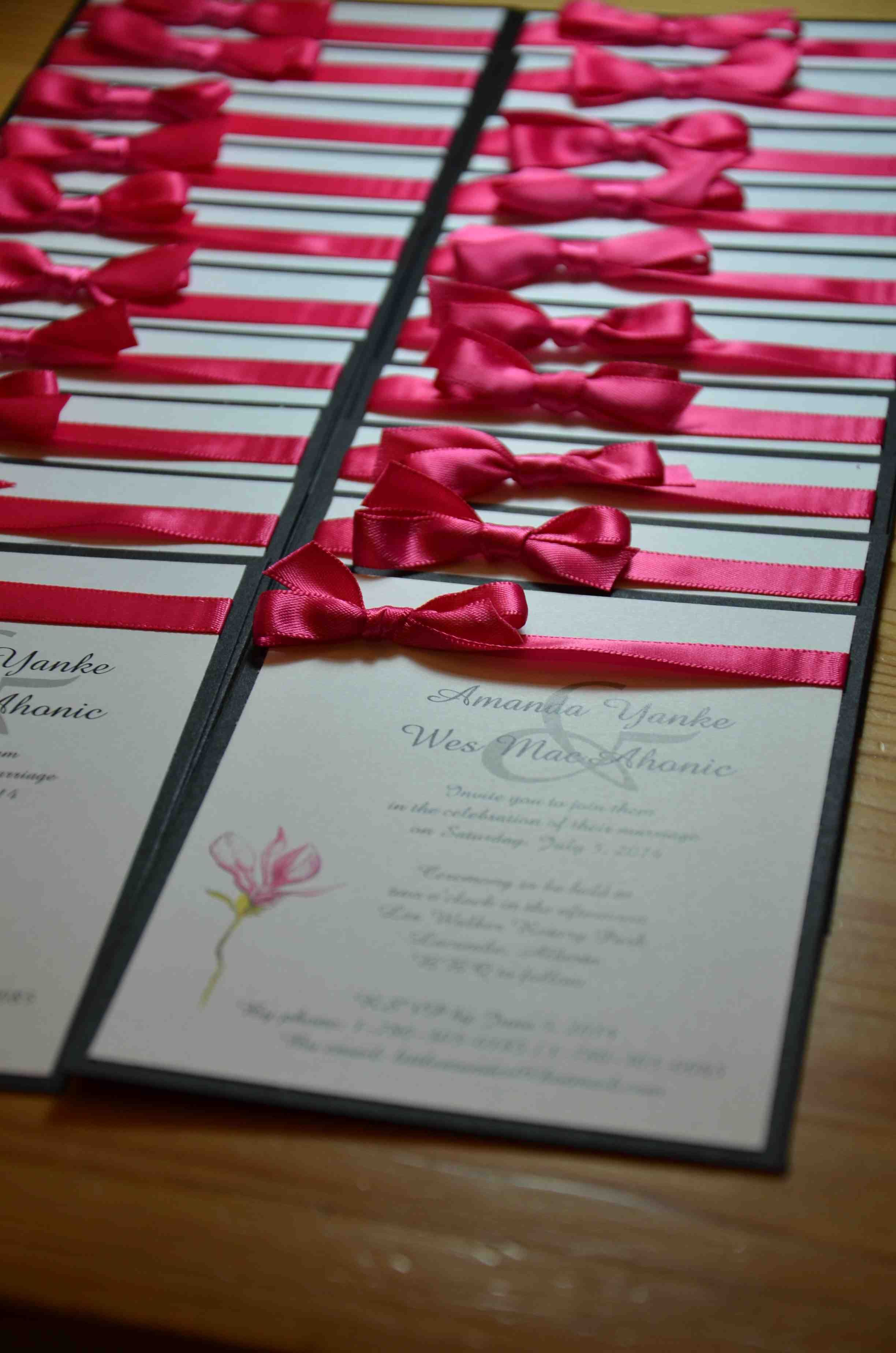 Wedding Invitation: White cardstock with pink flower on black matte ...