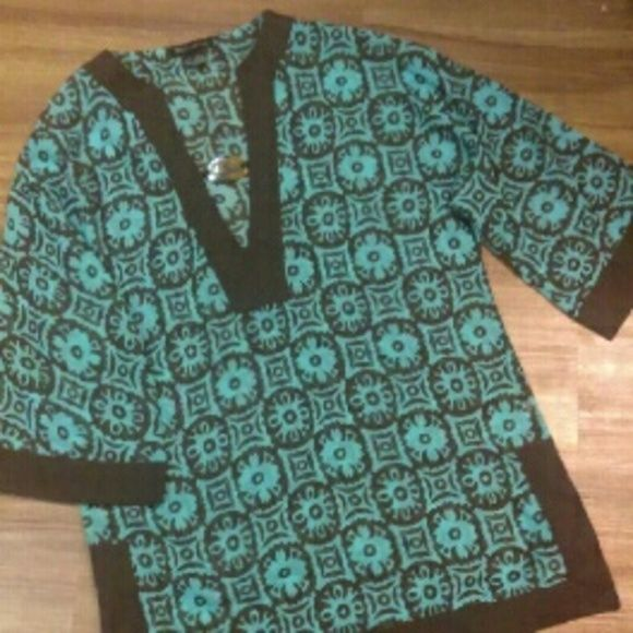 Beautiful sheer top Beautiful design, brown and turquoise with v-neck and brown stone that Connects the neck line. Super nice, perfect condition Tops Tunics