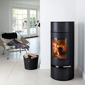 A Tall And Lean Wood Burning Stove Which Is Especially Suitable For Corners The Curve Modern Wood Burning Stoves Contemporary Wood Burning Stoves Wood Burner