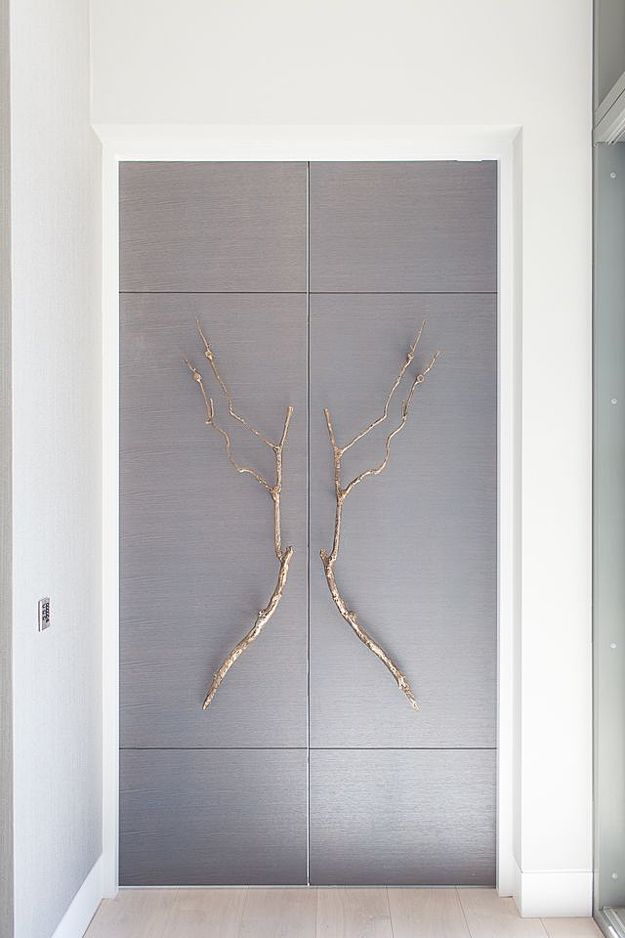 Bespoke doors with bronze branch handles Design by Stephenson